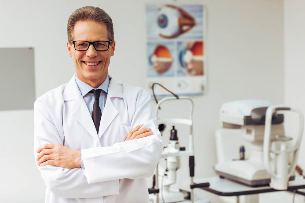 Middle Aged Ophthalmologist Looking at Camera and Smiling